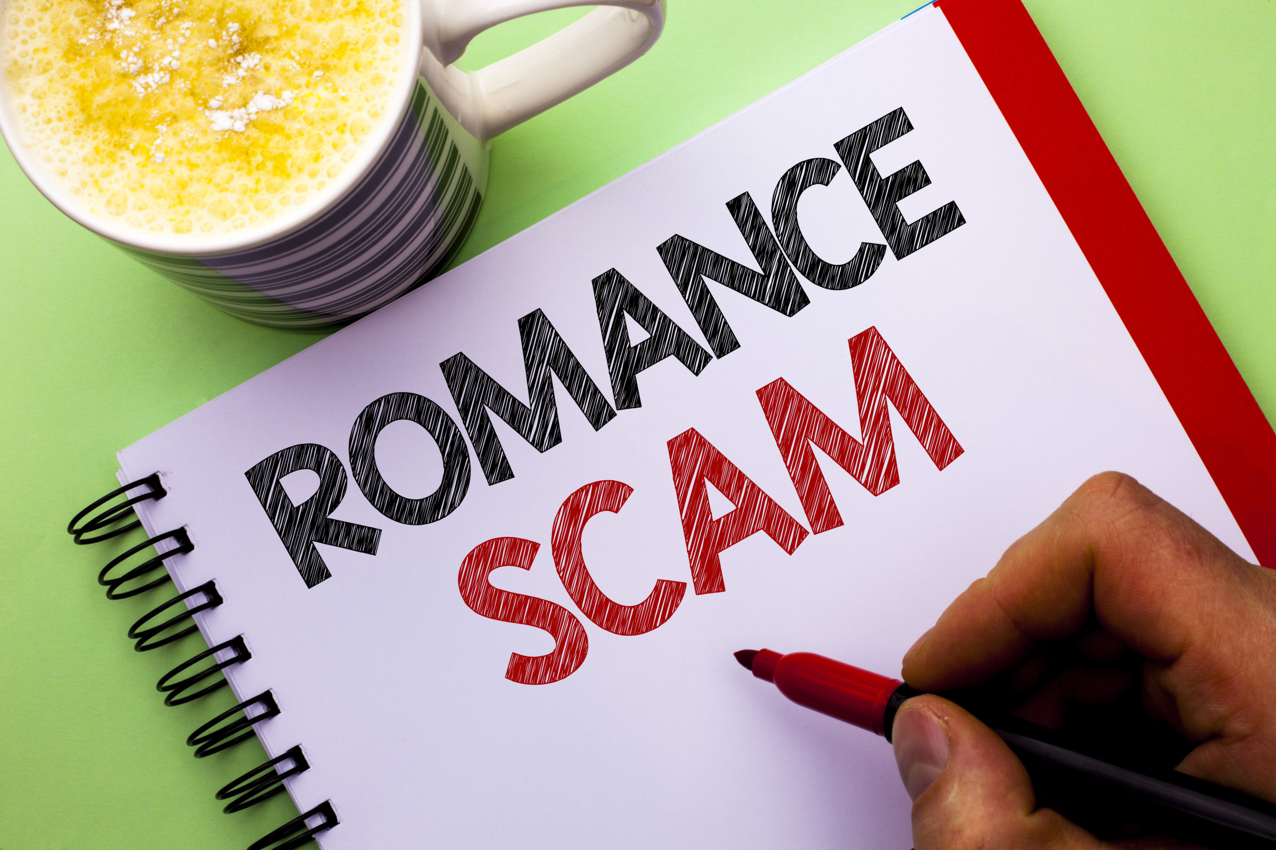 Word Writing Text Romance Scam. Business Concept For Dating Cheat Love Embarrassed Fraud Cyber Couple Affair Written By Man On Notebook Book Holding Marker On The Plain Background Coffee Cup